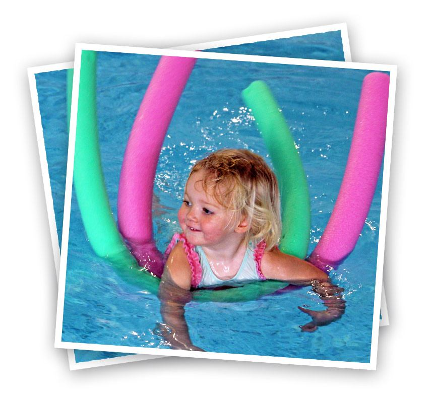 child swimming with woggle