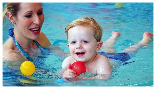 boy swimming with mum